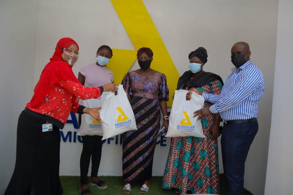 Female customers presented food donations at Addosser IWD